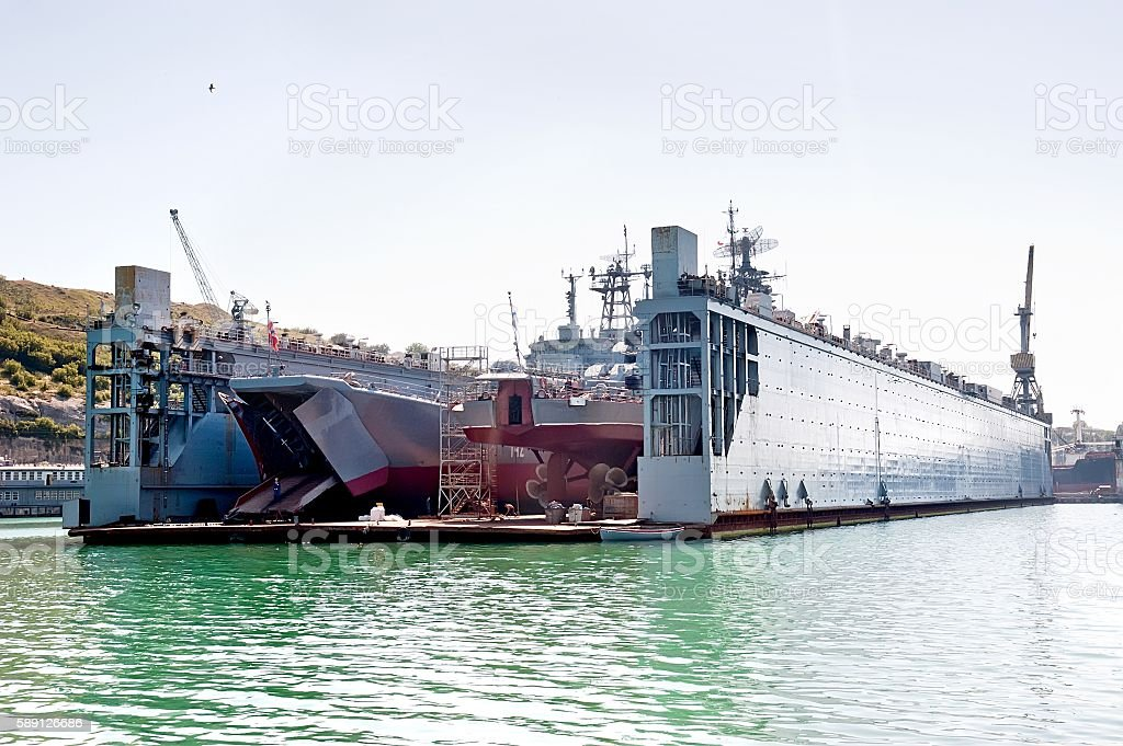 Floating dry dock with landing crafts. - foto de stock
