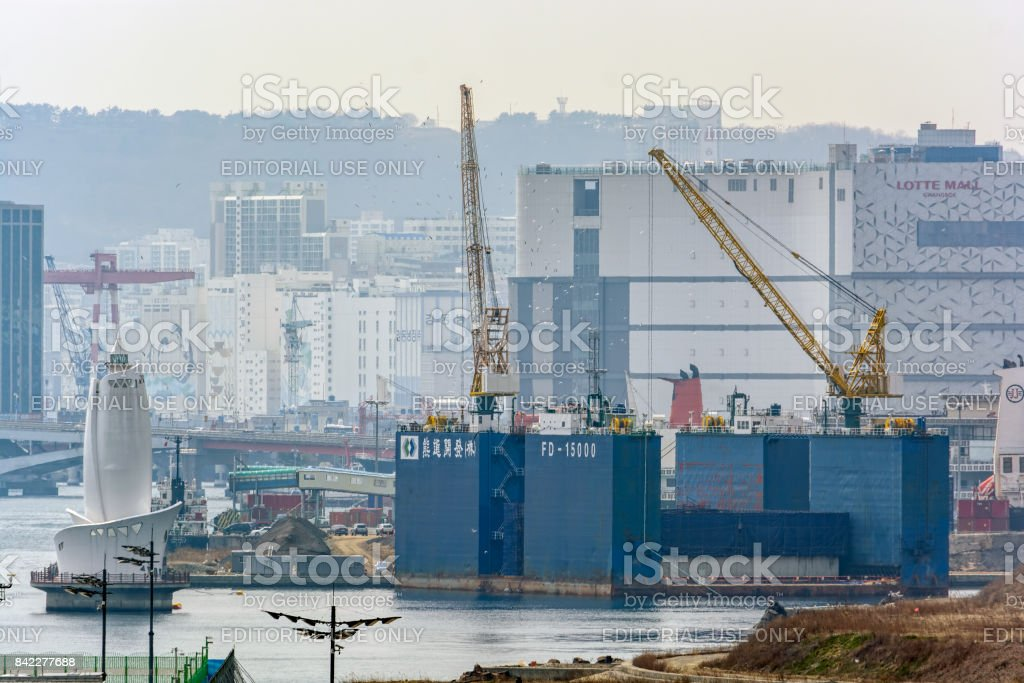 Floating drydock Woongjin FD-15000 with precast concrete section of the new bridge. stock photo