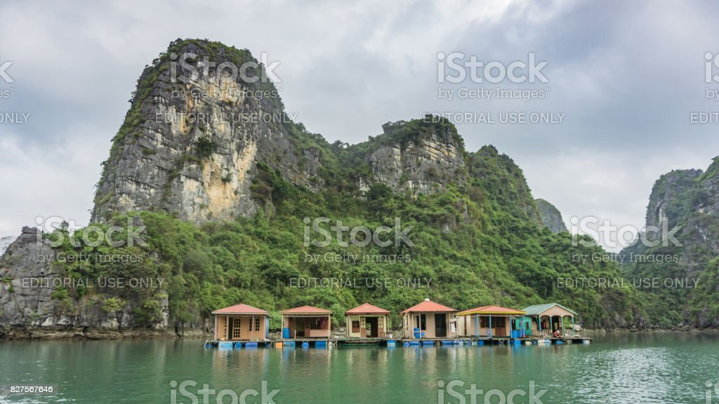 Floating fishing village and rock islands in Halong Bay, Vietnam stock photo