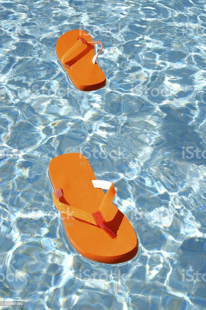 Floating flip flops royalty-free stock photo