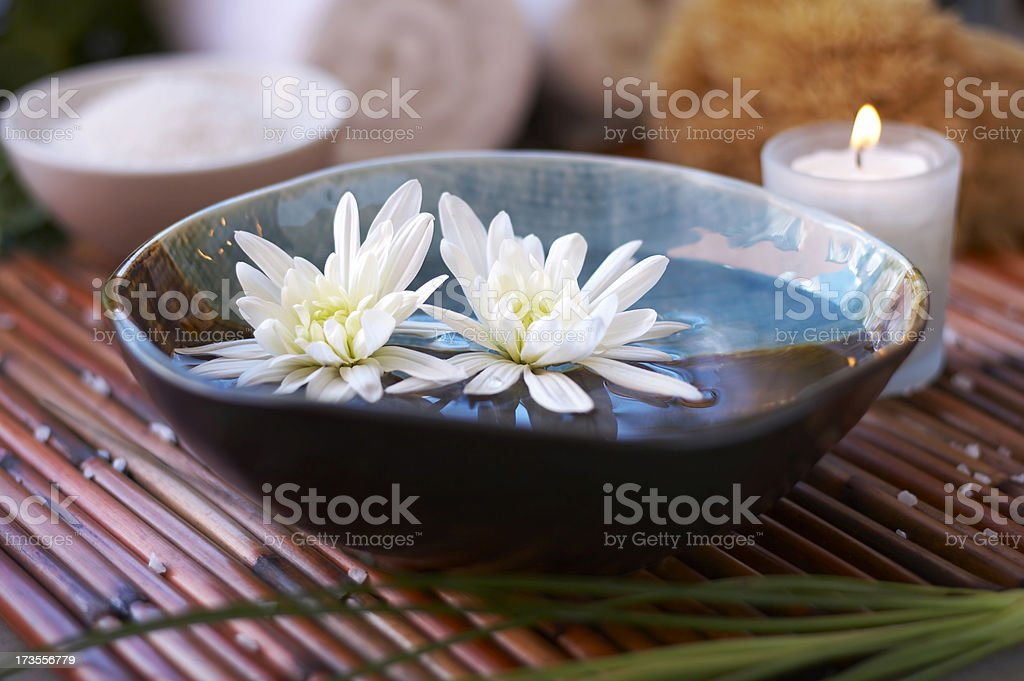 floating flowers in spa setting royalty-free stock photo