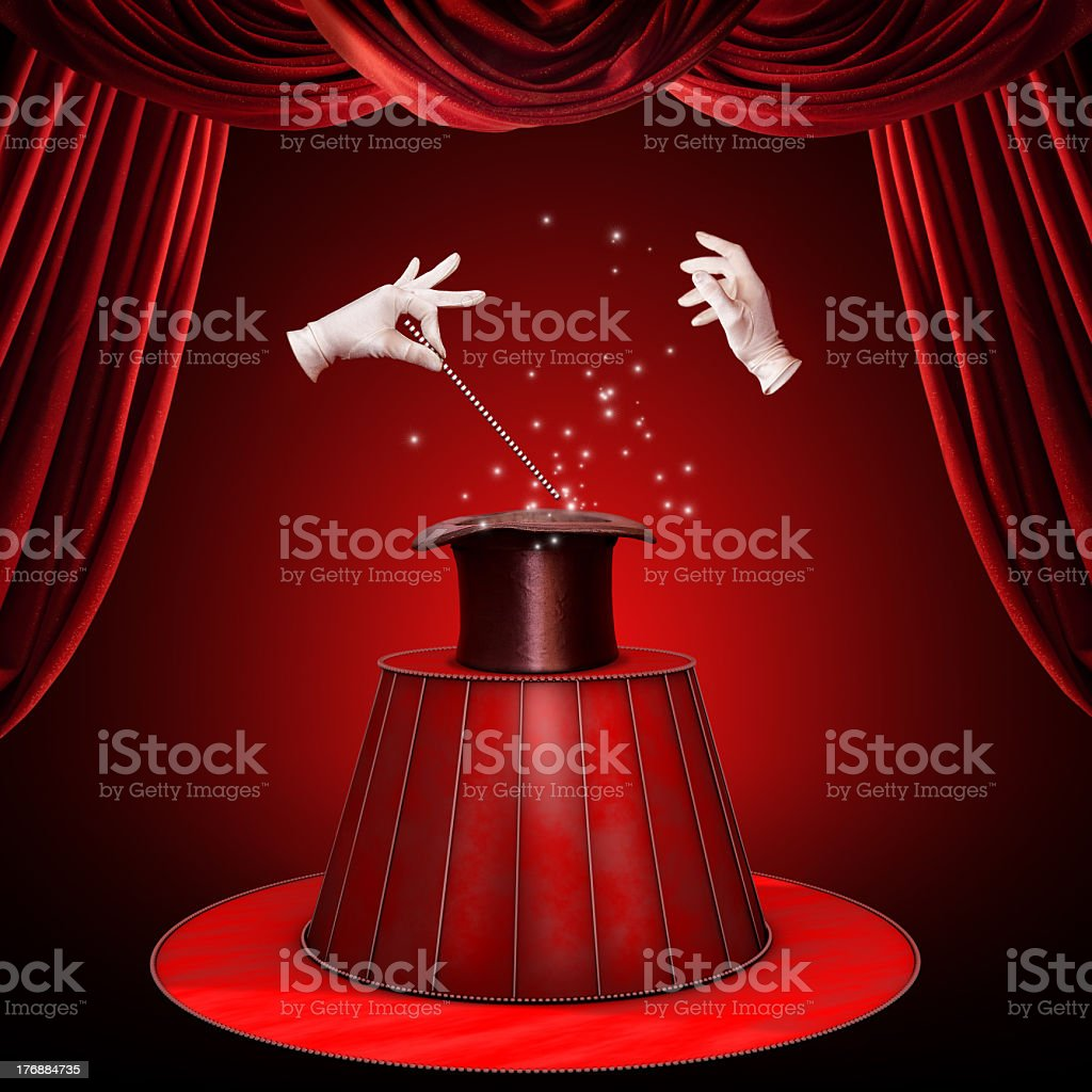 Floating hands perform magic trick with wand and hat stock photo
