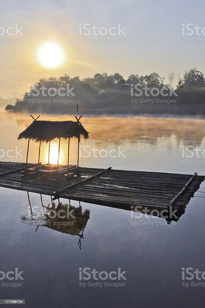 floating house with a fog in the morning royalty-free stock photo