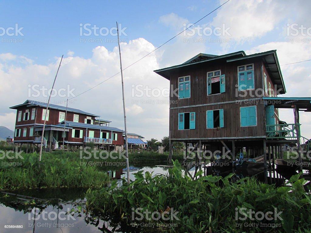 Floating houses of Inle Lake stock photo