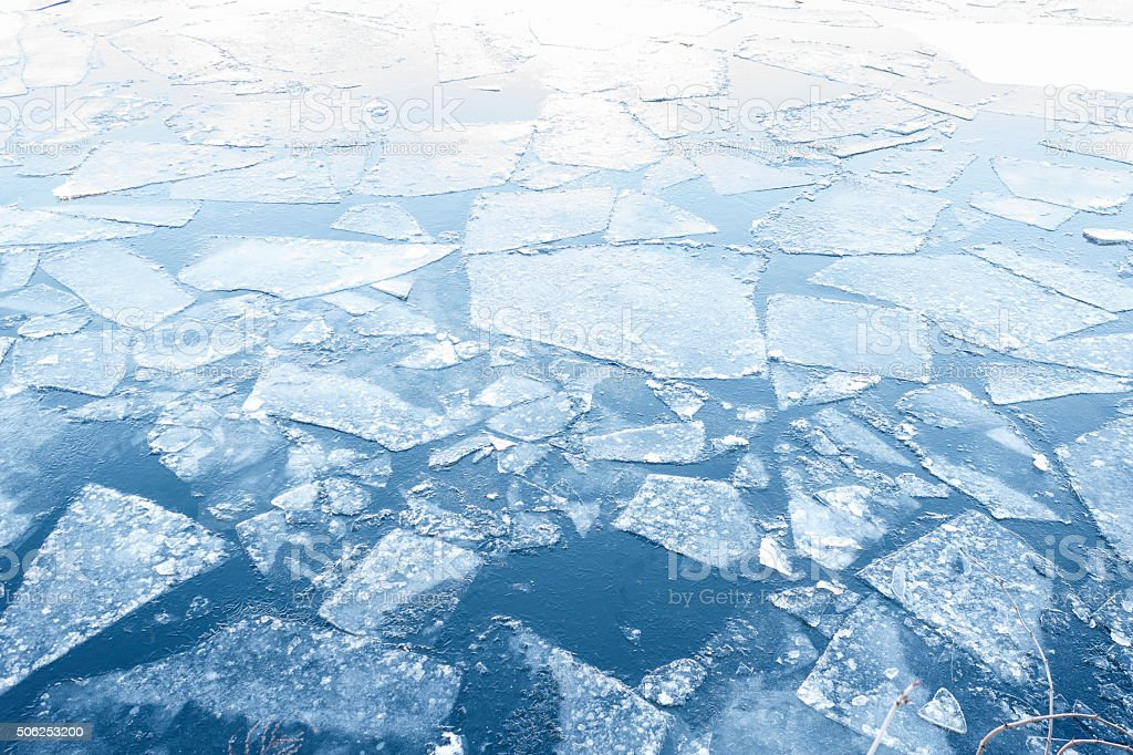floating ice floes on water - iced winter background stock photo