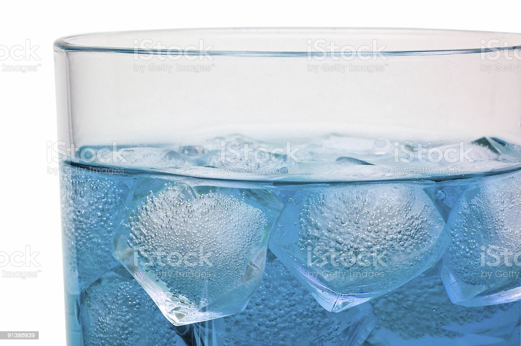 Floating ice in Curacao drink with clipping path stock photo