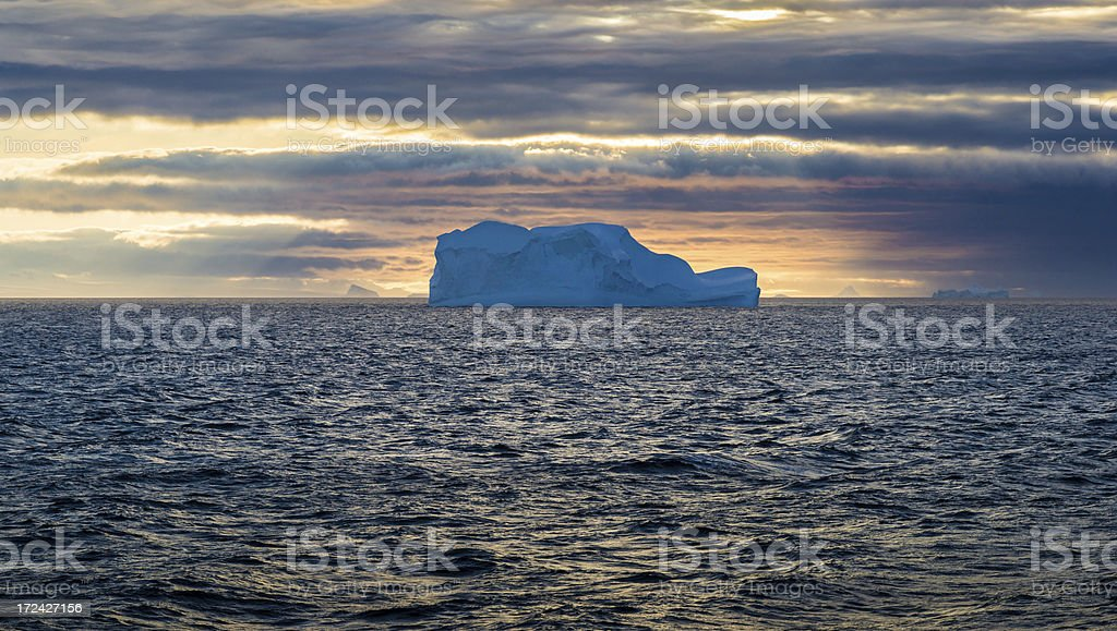 Floating Iceberg and Setting Sun in Antarctica royalty-free stock photo