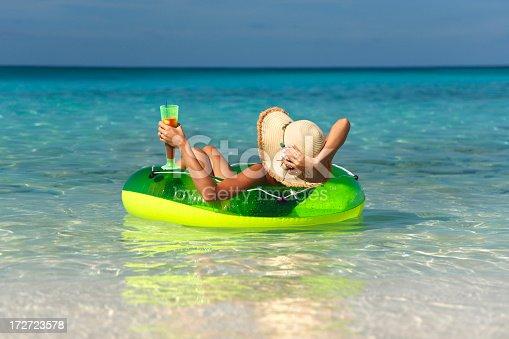 woman relaxing in an innertube at tropical paradise