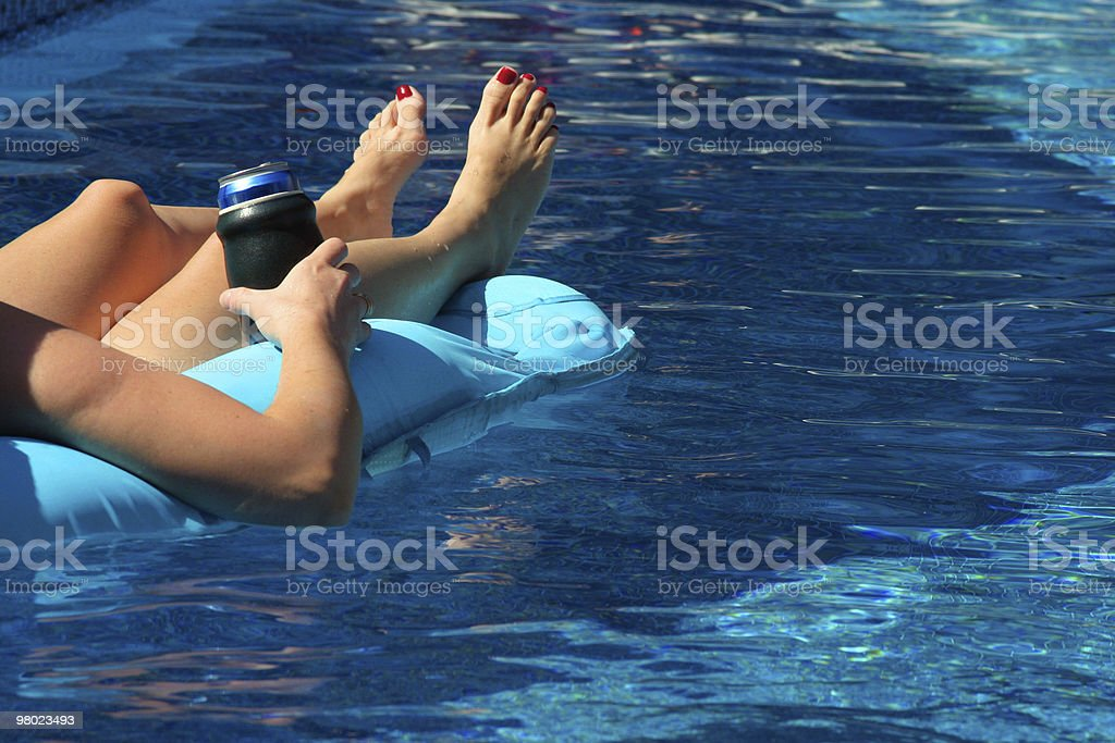 floating in pool royalty-free stock photo