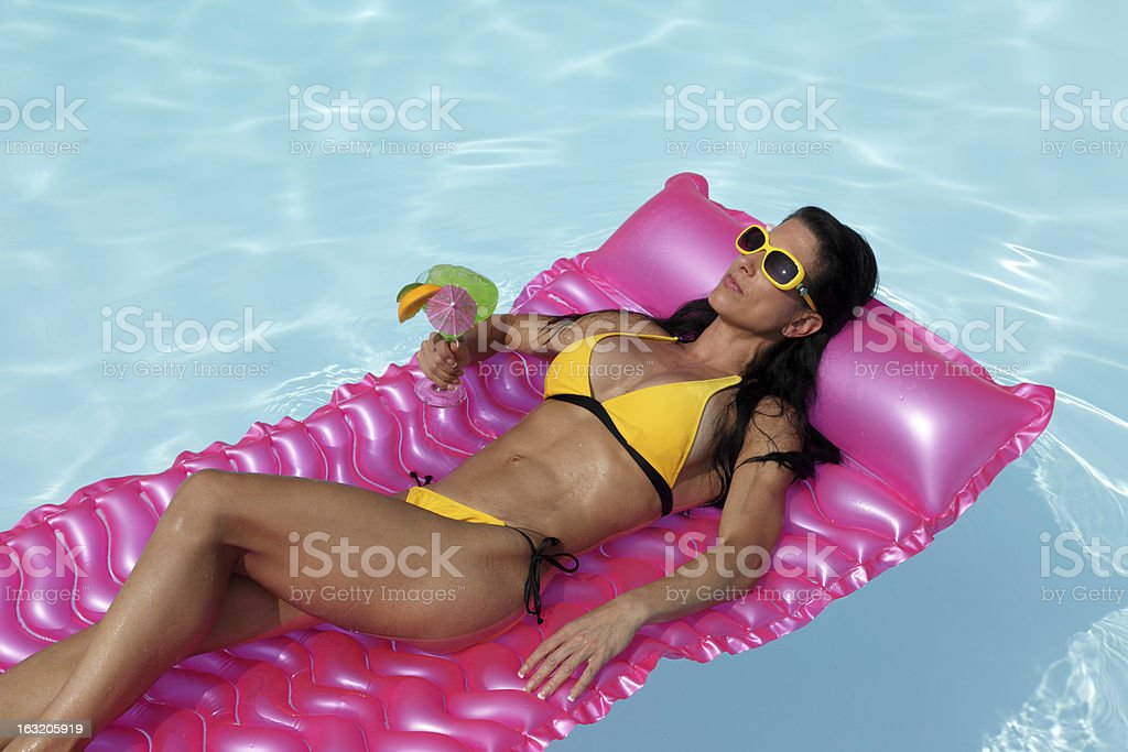 Floating In The Pool royalty-free stock photo