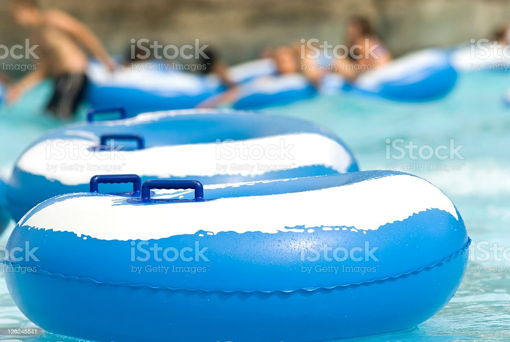 Floating inflatable devices aligned in a resort pool royalty-free stock photo