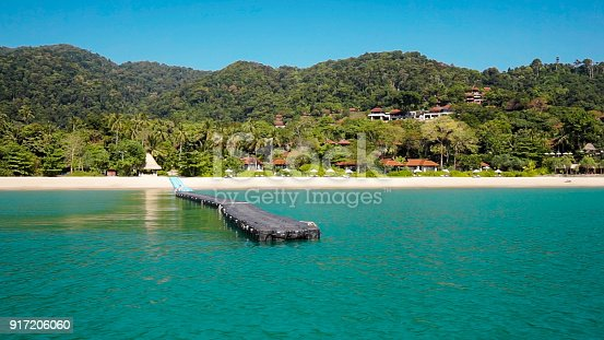The stunning tropical paradise that is Kantiang Bay, Ko Lanta, Krabi Province, Thailand.  These impressive islands are located in the Andaman Sea and are part of the National Marine Park.  Here we see the floating jetty that leads to the beach.