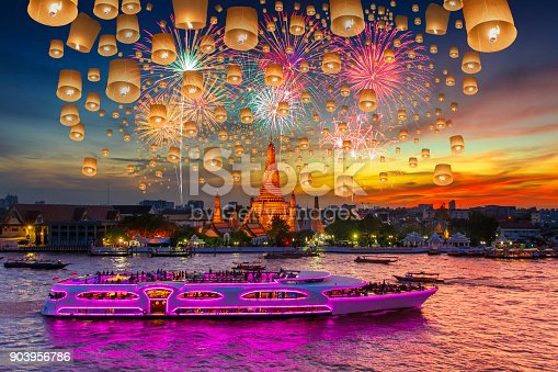 Floating lamp and Fireworks at Wat arun and cruise ship in sunset time under new year celebration, Bangkok city ,Thailand