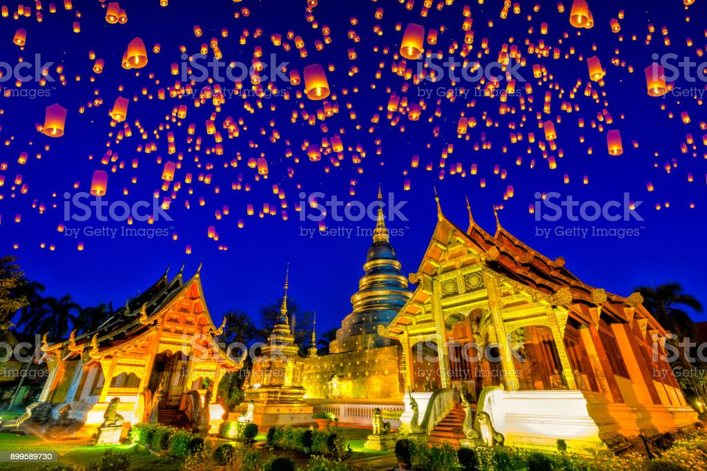 Floating lamp and krathong lantern in yee peng festival at Wat Phra Singh temple. This temple contains supreme examples of Lanna art in the old city center of Chiang Mai,Thailand. stock photo