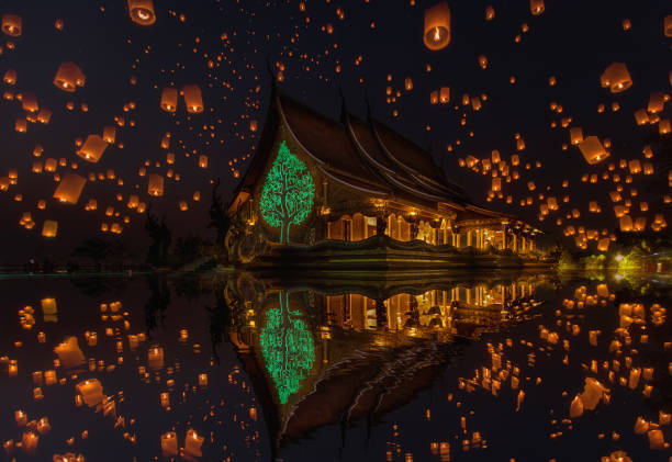 floating lamp in yee peng festival at pagoda tree glow temple wat sirindhorn wararam, sirindhorn district, ubon ratchathani - kratong stock photos and pictures