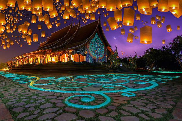 floating lamp in yee peng festival - kratong stock photos and pictures