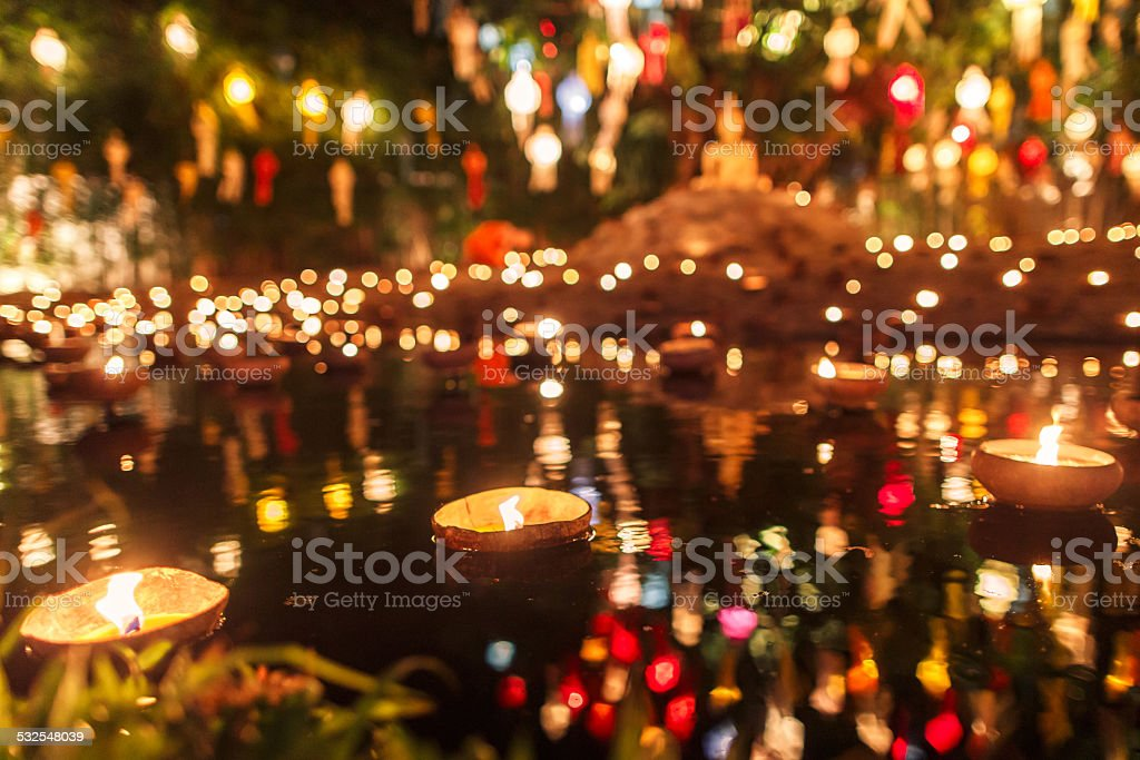 Floating lantern with monk and buddha image in Thai temple stock photo