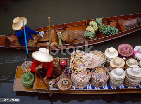 Floating market in Bangkok, Thailand. Looking down onto boats filled up with hats and vegetables ready for sale.