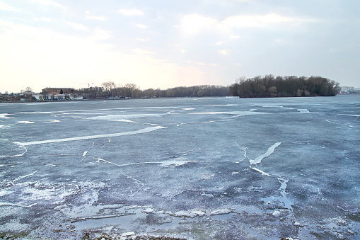floating of ice on river at early spring evening