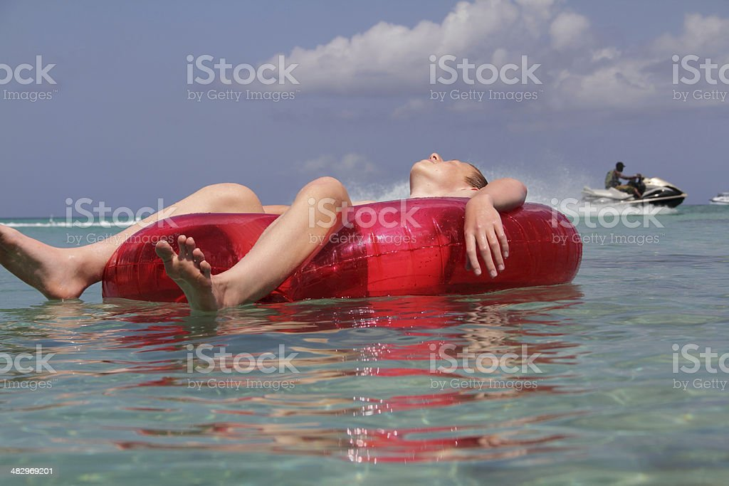 floating on sea stock photo