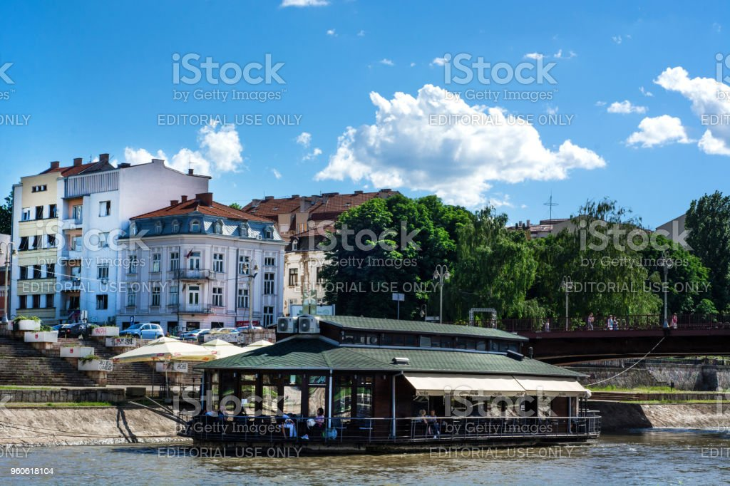 Floating Restaurant on Nisava river on sunny day and city landscape stock photo