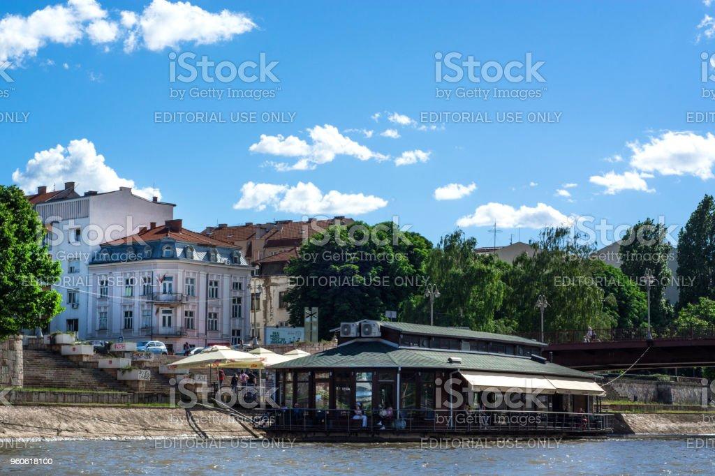Floating Restaurant on Nisava river on sunny day stock photo