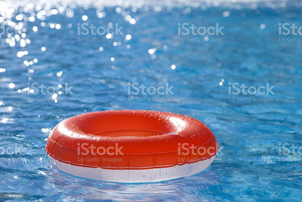 floating  ring on blue water swimpool royalty-free stock photo