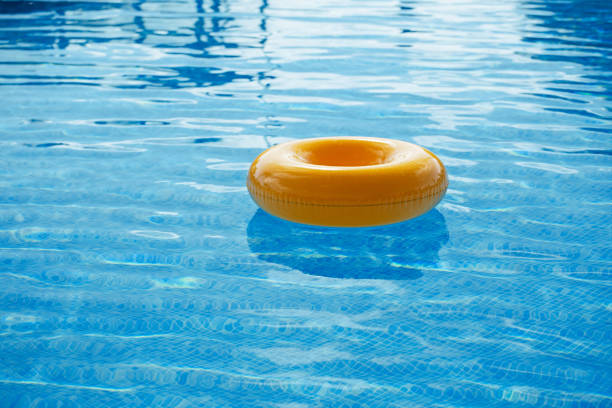 floating ring on blue water swimpool stock photo