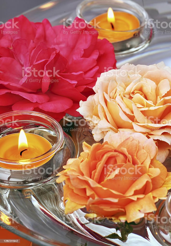Floating roses and candles royalty-free stock photo