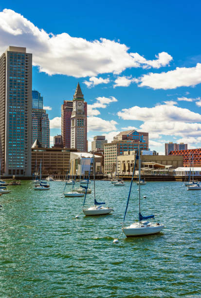 Floating sailboats and the skyline of Financial District in Boston stock photo