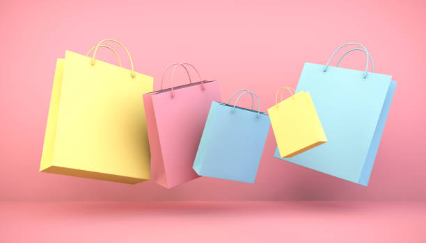 floating shopping bags stock photo