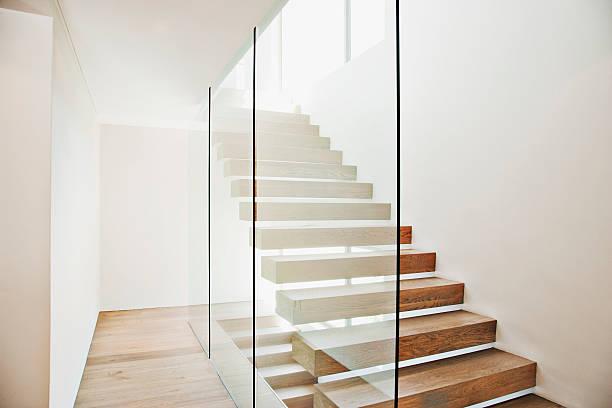 Floating staircase and glass walls in modern house stock photo
