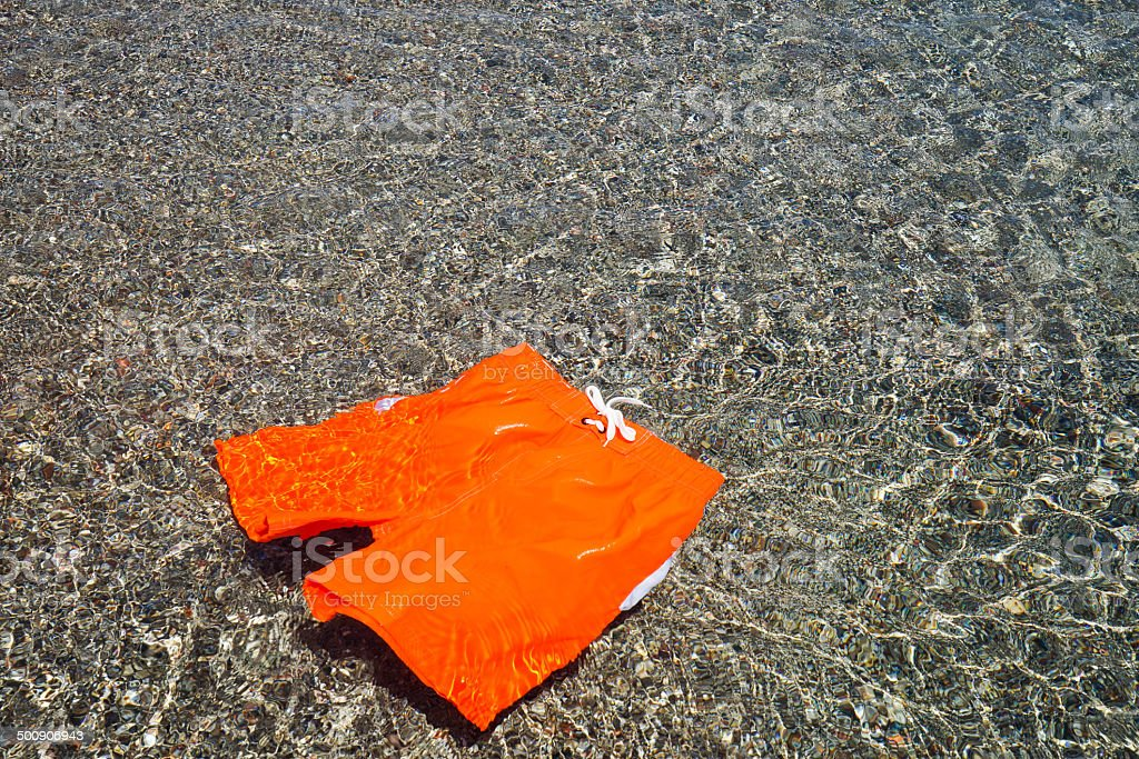 Floating swimming shorts in the sea stock photo