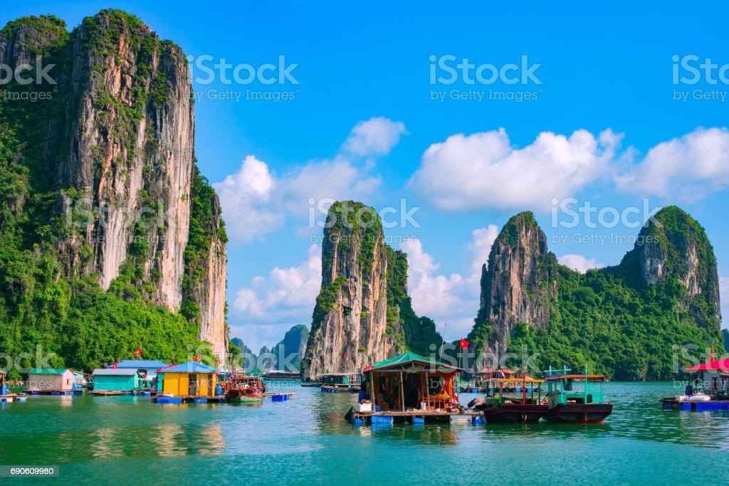 Floating village, rock island, Halong Bay, Vietnam stock photo