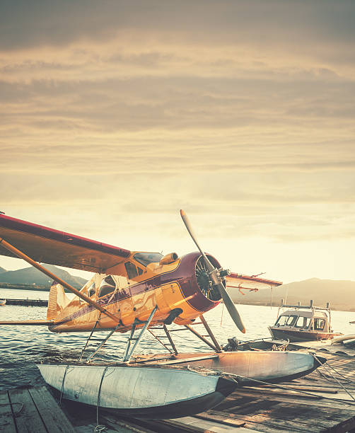 Floatplane in Sunset Float plane dock in Ketchikan Alaska.  Stitched images. ketchikan stock pictures, royalty-free photos & images