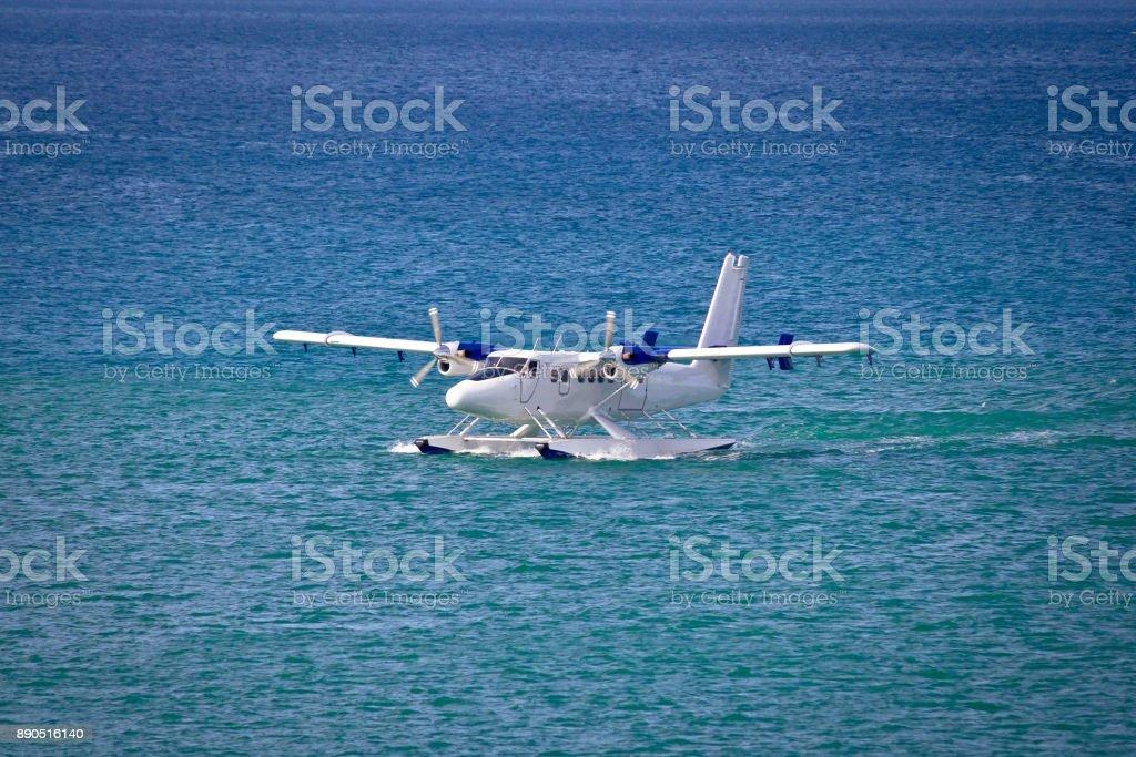 Floatplane mooring on open turquoise sea stock photo