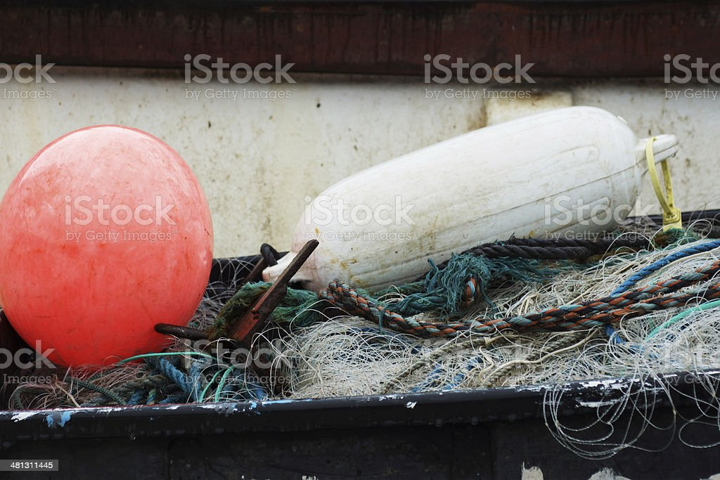 floats and nets on a working Fishing boat stock photo