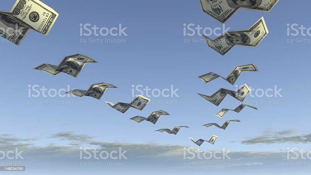 flock of dollar fly away stock photo