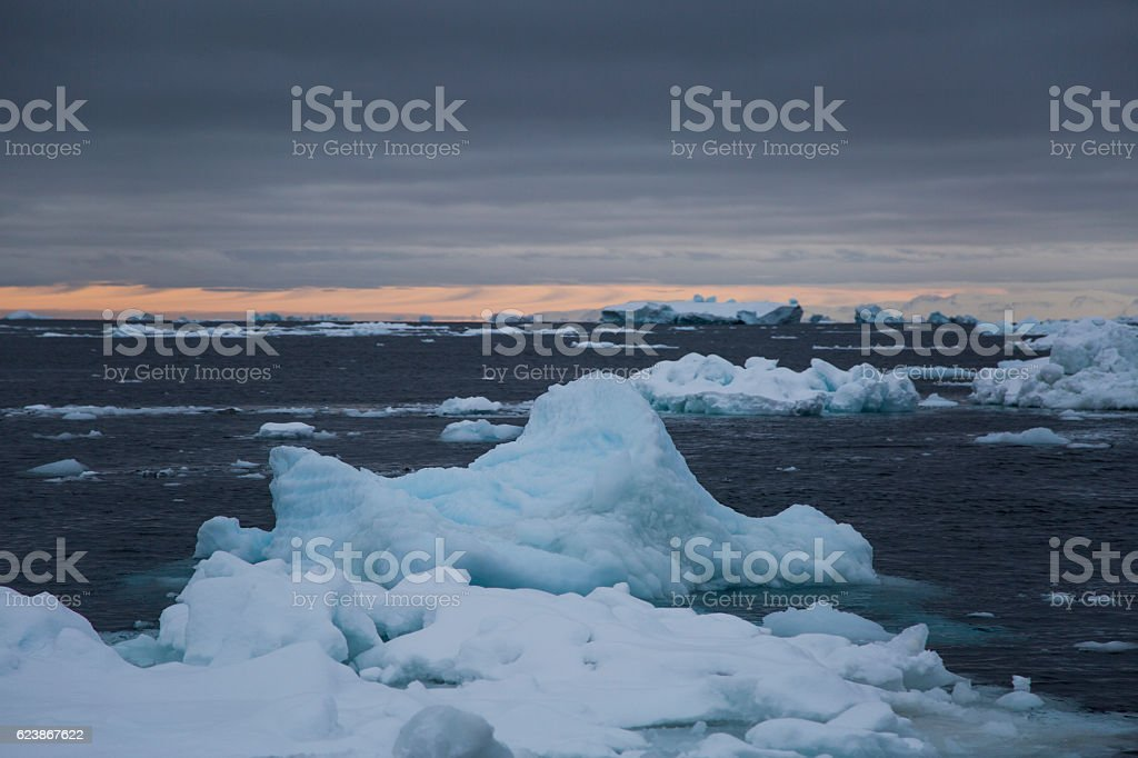 Floe in the ocean with dramatic sinister sky stock photo