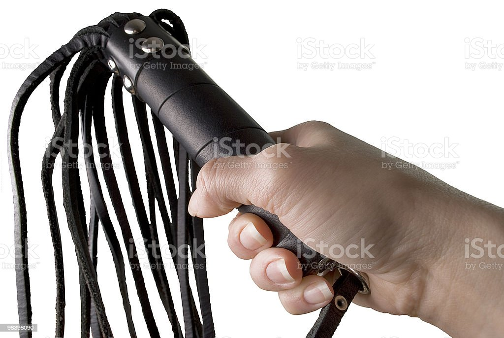 Flogging Whip in woman's hand royalty-free stock photo