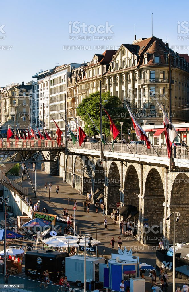 Flon district with Grand pont bridge with flags in Lausanne stock photo