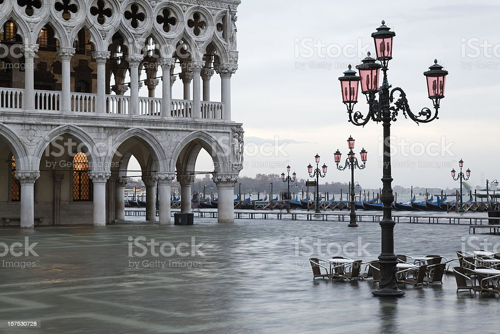 Flood at dawn on St. Mark´s Square in Venice royalty-free stock photo