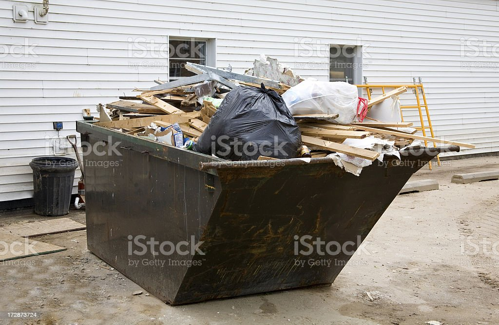 flood damage dumpster stock photo