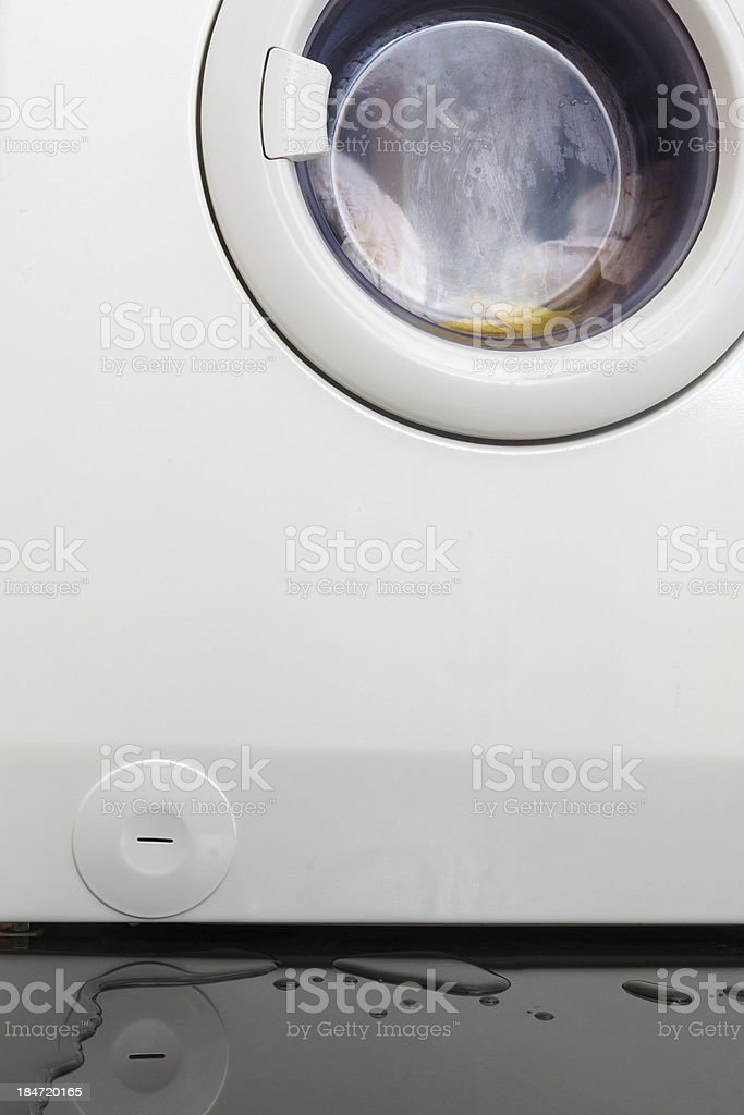 flood from faulty washing machine stock photo