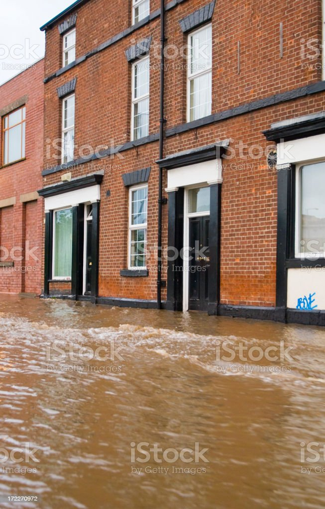 Flood in front of a brick building royalty-free stock photo