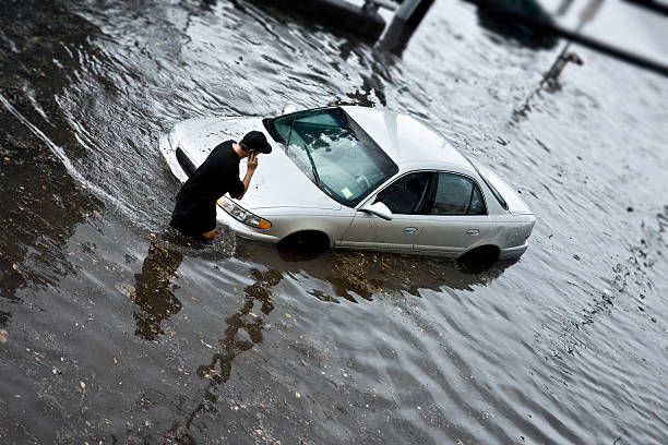 Flood Insurance Auto Stuck in Flood Waters.more images from the wading stock pictures, royalty-free photos & images