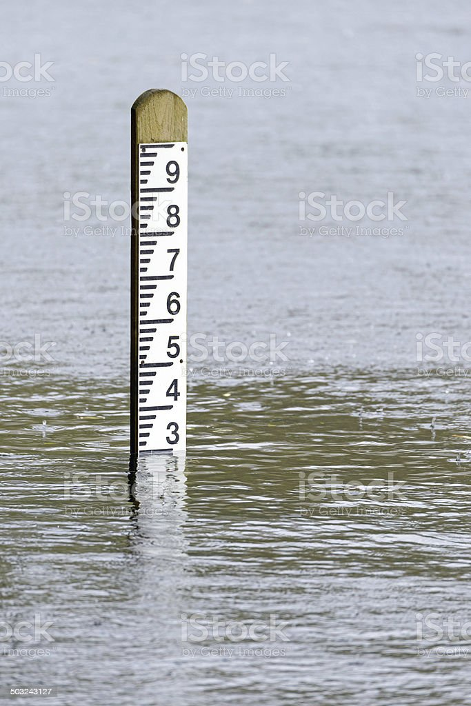 Flood level water depth marker post stock photo
