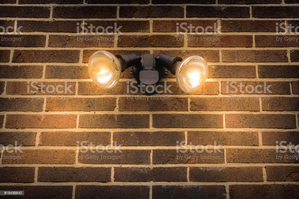 Flood light on external brick wall daytime look up stock photo