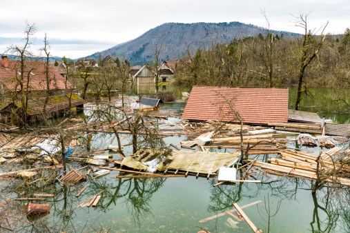 Some rural houses in the village under several meters of real flood waters. Lake Planinsko polje has floded because of long period of rain. Slovenia.