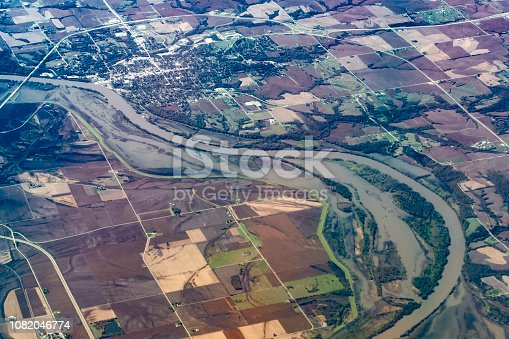 Aerial view of flood plain along the Missouri River at Nebraska City, Nebraska, USA. View looking south. Green levee (Army Corps of Engineers, Missouri River Levee System L-575) dividing farmland in Iowa from flood plain visible to left of river.